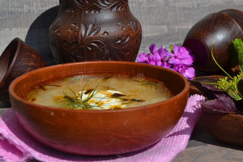 Cabbage soup made from sauerkraut with red pepper. Russian cuisine, ceramic bowls. Cabbage soup made from sauerkraut with red pepper. Russian cuisine, ceramic royalty free stock image