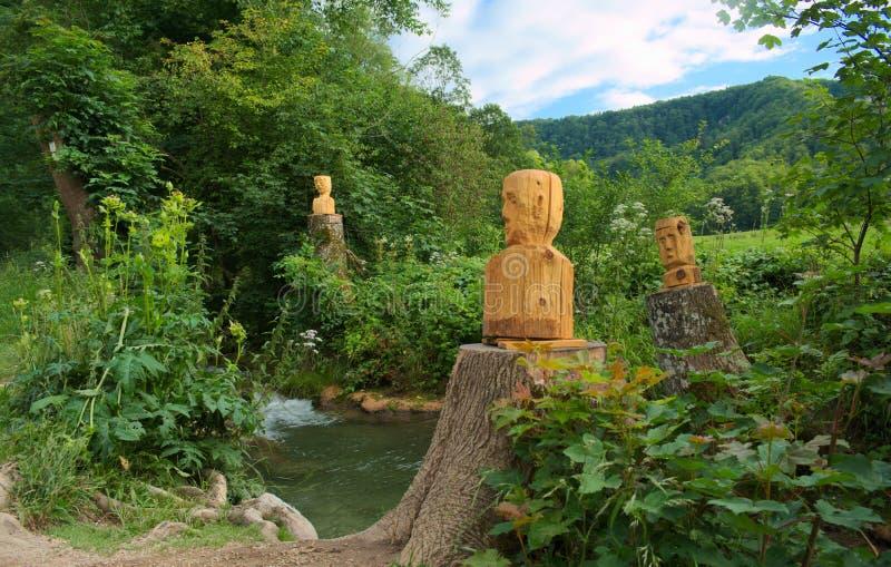 Cabeça de madeira em Alemanha, água fotos de stock