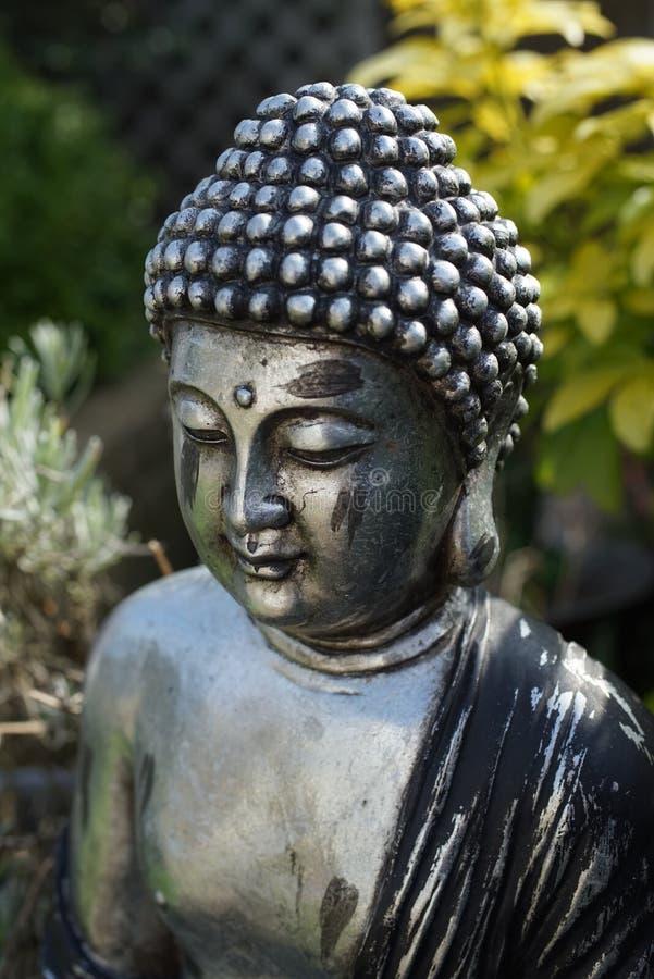 Cabeça do ornamento do jardim da Buda imagem de stock