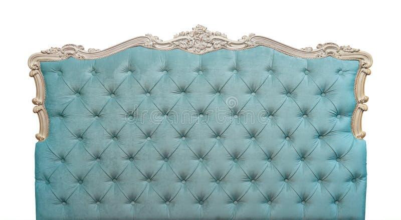 Cabecero azul de la cama del terciopelo aislado en blanco fotos de archivo