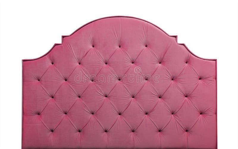 Cabecero rosado de la cama del terciopelo aislado en blanco imagen de archivo