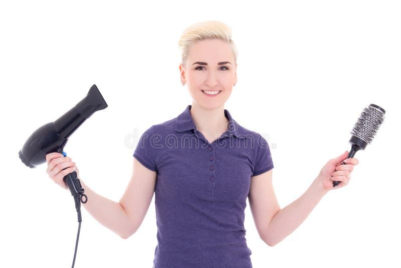 Cabeleireiro bonito novo da mulher com o equipamento isolado no wh imagem de stock