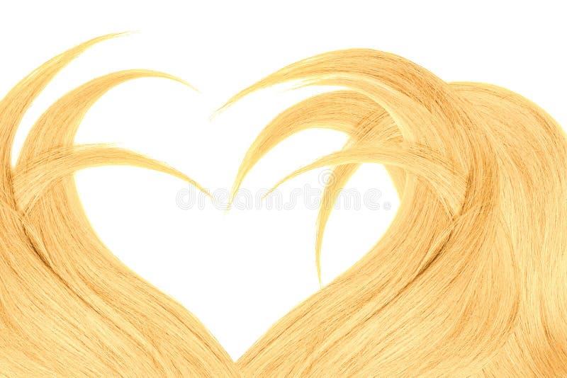 Cabelo louro na forma do coração, isolada no fundo branco fotos de stock