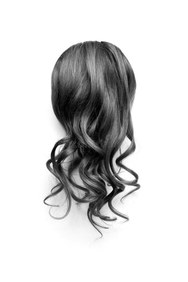 Cabelo preto ondulado natural no fundo branco A opinião principal da mulher para trás fotografia de stock