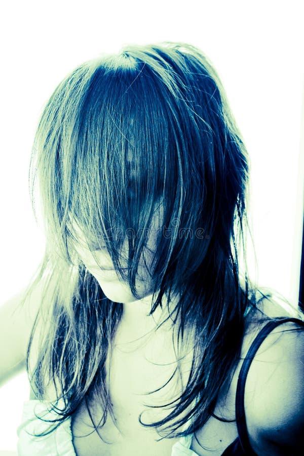 Cabelo sobre a face de uma menina fotos de stock