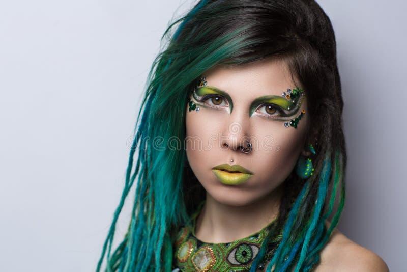 Cabelo verde da mulher imagem de stock royalty free