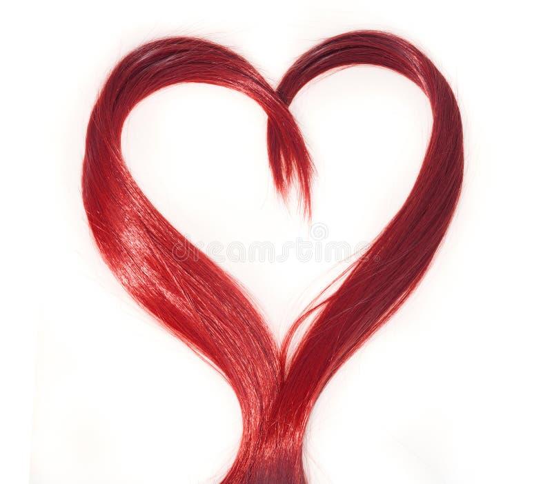 Cabelo vermelho do fogo com forma do coração fotografia de stock