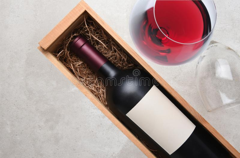 Cabernet Sauvignon: A bottle in wood case with a glass of red wi royalty free stock image