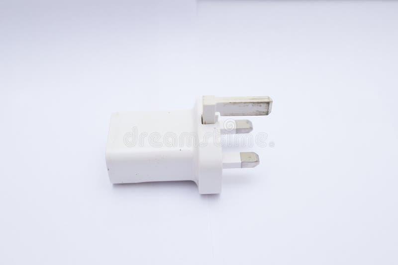Cabeza/adaptador blancos del cargador USB en un fondo blanco foto de archivo libre de regalías