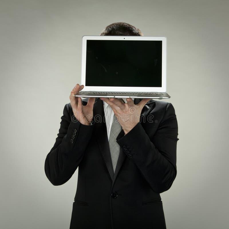 Cabeza al comercio electrónico, ordenador en vez de la cara imágenes de archivo libres de regalías