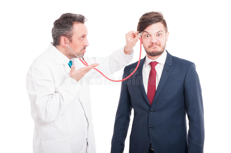 Cabeza cheking del médico profesional del abogado insano imagenes de archivo