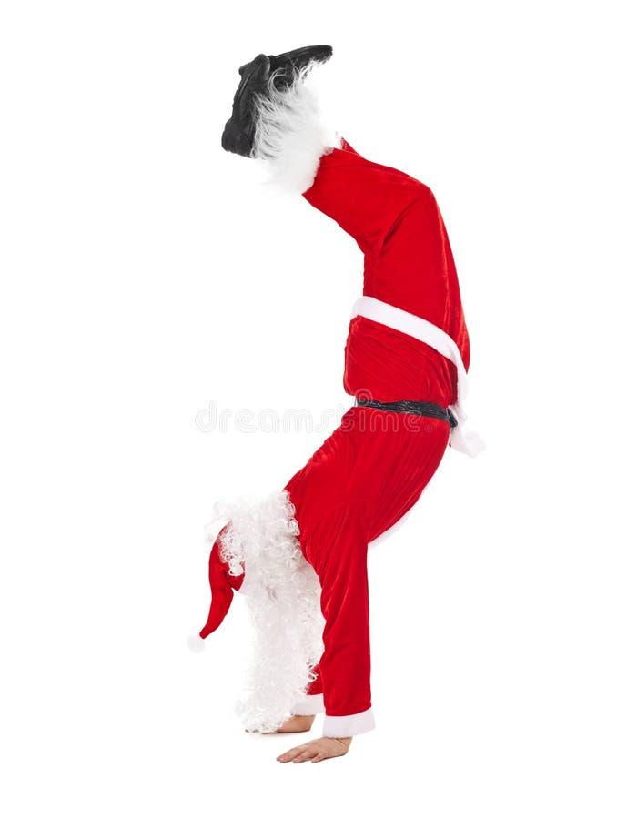 Cabeza derecha de Santa Claus sobre pies imagenes de archivo