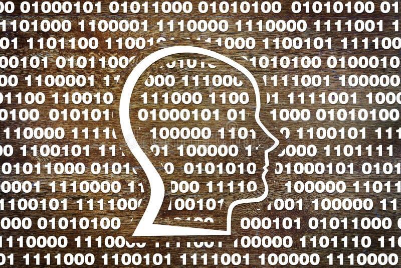 Cabeza humana en código binario foto de archivo libre de regalías