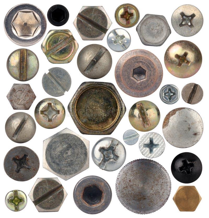 Cabezas de tornillo, nueces, remaches imagenes de archivo