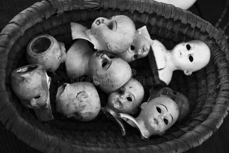 Cabezas fantasmagóricas de la muñeca foto de archivo