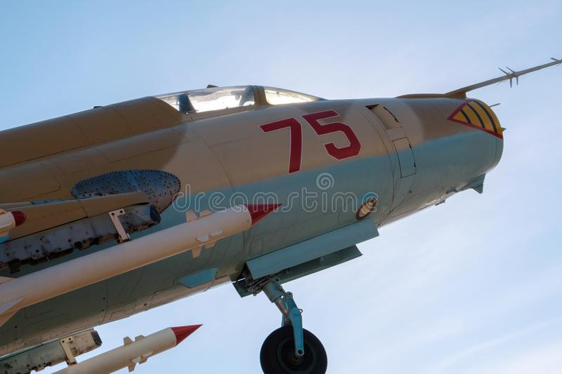 Cabin against the background of the sun and the blue sky, the cabin of the military aircraft of the USSR fighter aircraft. With the numbers 75 on board stock image