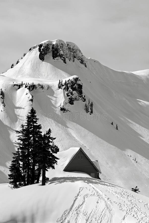 A cabin buried in heavy snow up at Mt. Baker Ski Resort stock photography