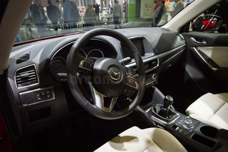 Cabin of a compact crossover SUV Mazda CX-5 AWD. BERLIN - SEPTEMBER 04, 2015: Cabin of a compact crossover SUV Mazda CX-5 AWD. International radio exhibition stock image