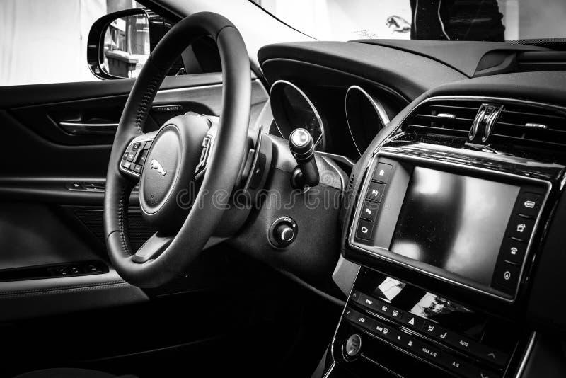 Cabin of the compact executive car Jaguar XE 20D (since 2015). BERLIN - JUNE 14, 2015: Cabin of the compact executive car Jaguar XE 20D (since 2015). Black and royalty free stock photos