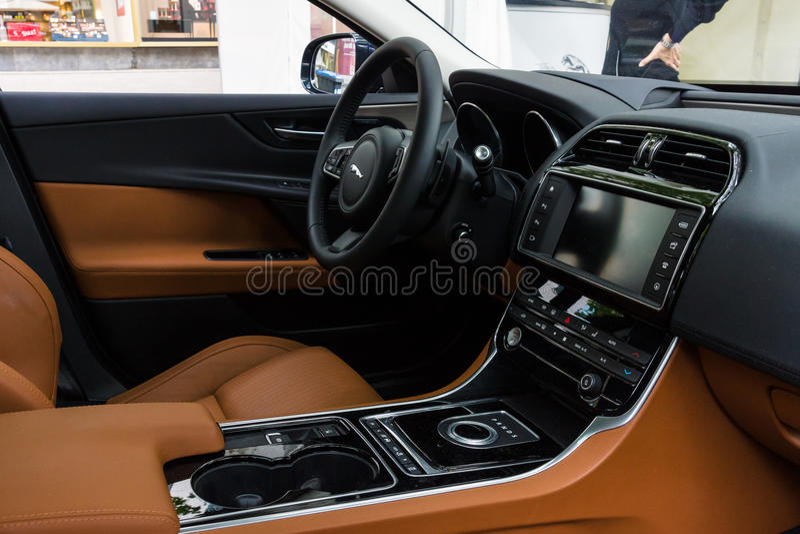 Cabin of the compact executive car Jaguar XE 20D (since 2015). BERLIN - JUNE 14, 2015: Cabin of the compact executive car Jaguar XE 20D (since 2015). The royalty free stock images