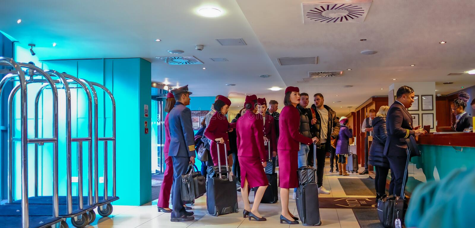 Cabin crew checking into their overnight stop off. Shows crew queing up to check in stock photo
