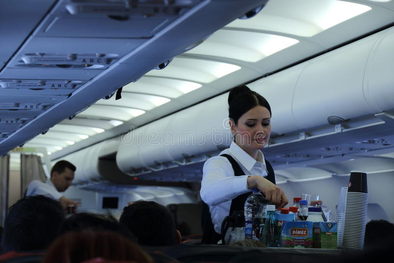 Cabin crew serving refreshments royalty free stock photography