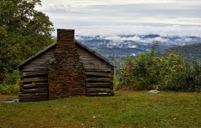 Cabin and fog in the Blue Ridge Mountains royalty free stock images