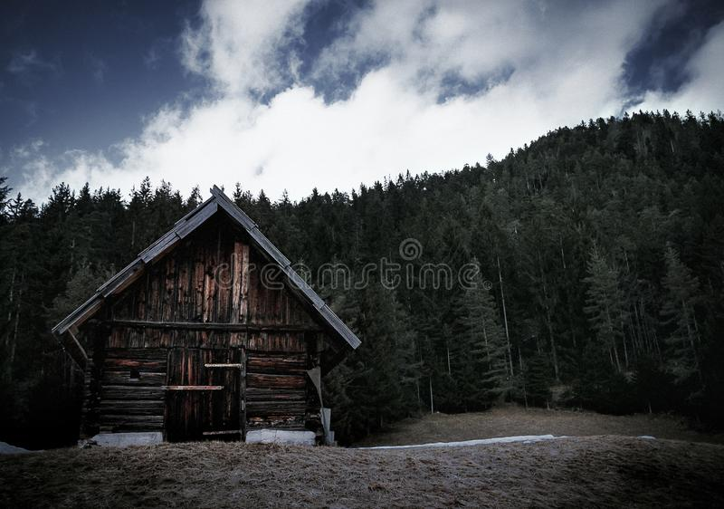 Cabin in the forest of italy at the mountains stock photos