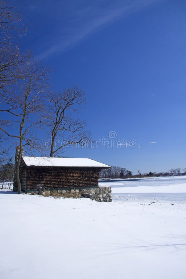 Download Cabin on frozen lake stock photo. Image of blue, bright - 1938666