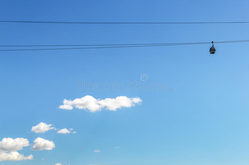 Cabin of Nizhny Novgorod Cableway on the background of the white clouds royalty free stock photography