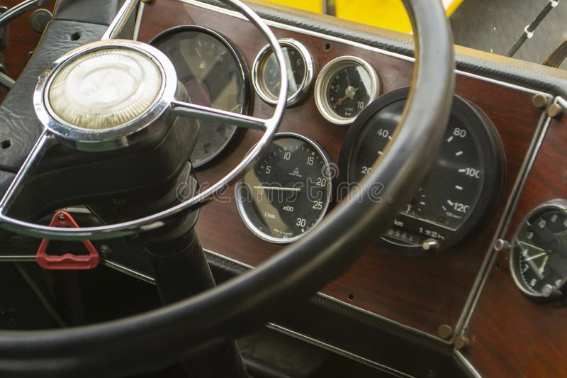 The cabin of the old bus. Vintage dashboard. Leather steering wheel royalty free stock images