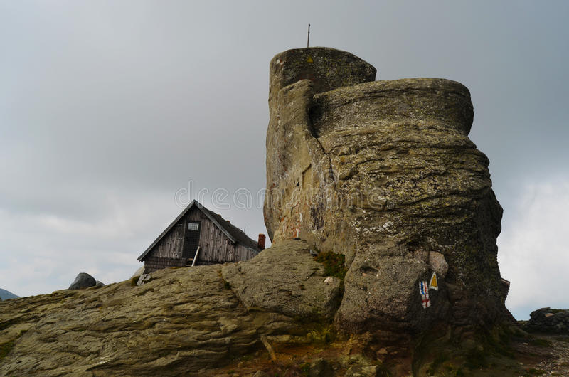 Cabin on Omu peak in Bucegi Mountains. High altitude mountain hut, next to the highest peak (Omu - 2505 m) of Bucegi mountains, Romania stock image