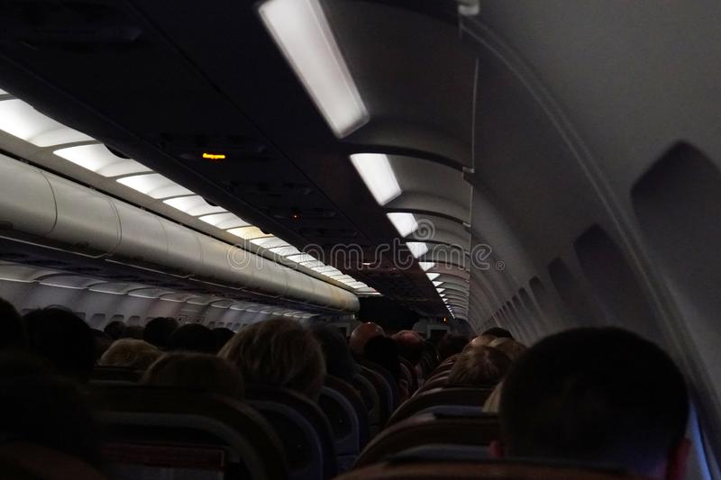 The cabin with passengers during take-off trip stock images
