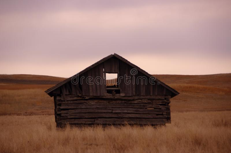 Cabin on the prairie. royalty free stock images