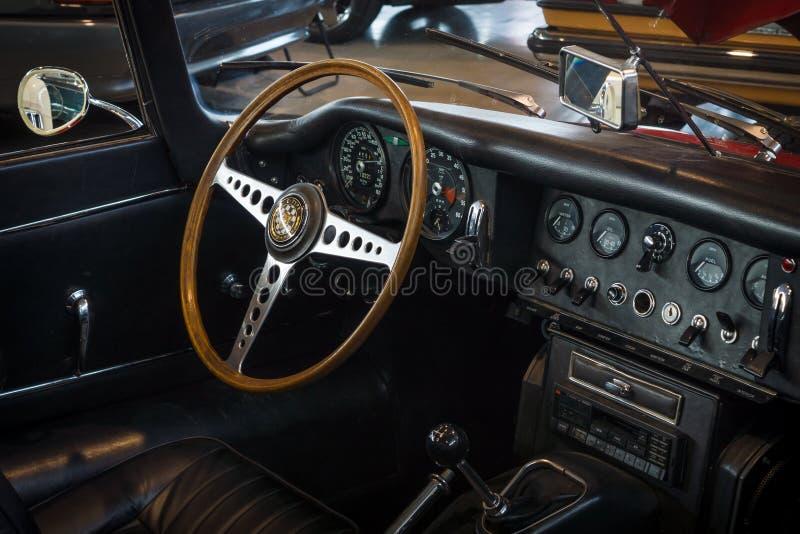 Cabin of sports car Jaguar E-Type 4.2 Serie I roadster, 1967. STUTTGART, GERMANY - MARCH 18, 2016: Cabin of sports car Jaguar E-Type 4.2 Serie I roadster, 1967 stock images