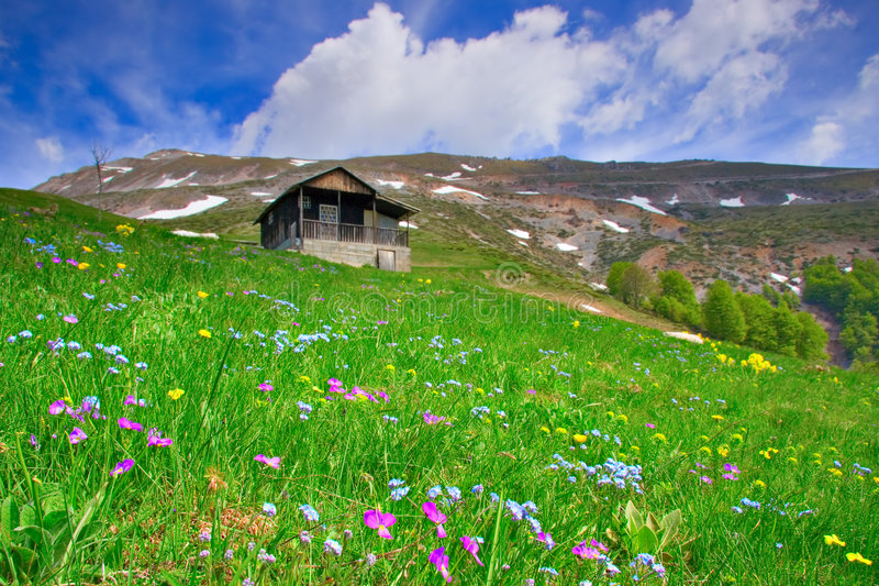 Cabin up in the mountains and a meadow in Macedonia stock photos