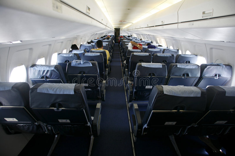 Cabin view of seats on plane royalty free stock photography