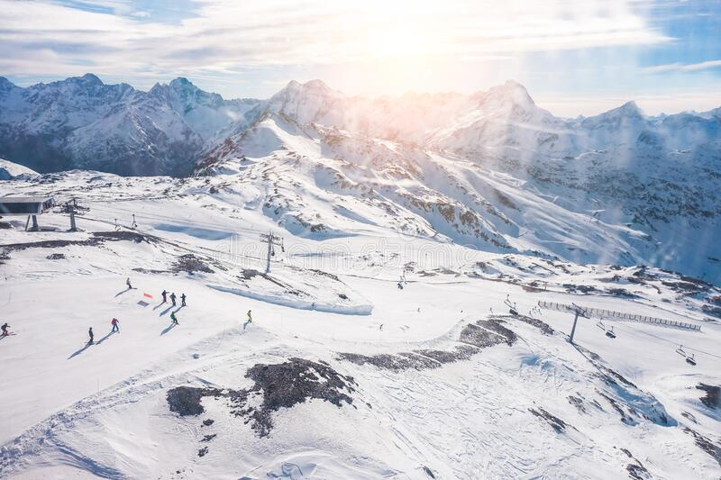 Cabin window view of people skiing in winter resort - Holidays, extreme sport gear renting, snowboarding and mountain landscape. Concept - Focus on ski snow royalty free stock image