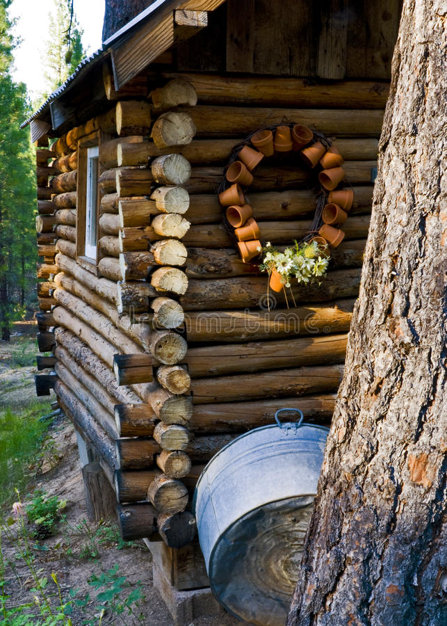 Cabin In The Woods With Decorations Royalty Free Stock Image