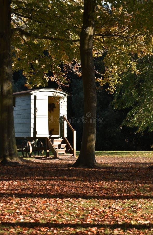 Cabin in the woods vintage caravan stock photography
