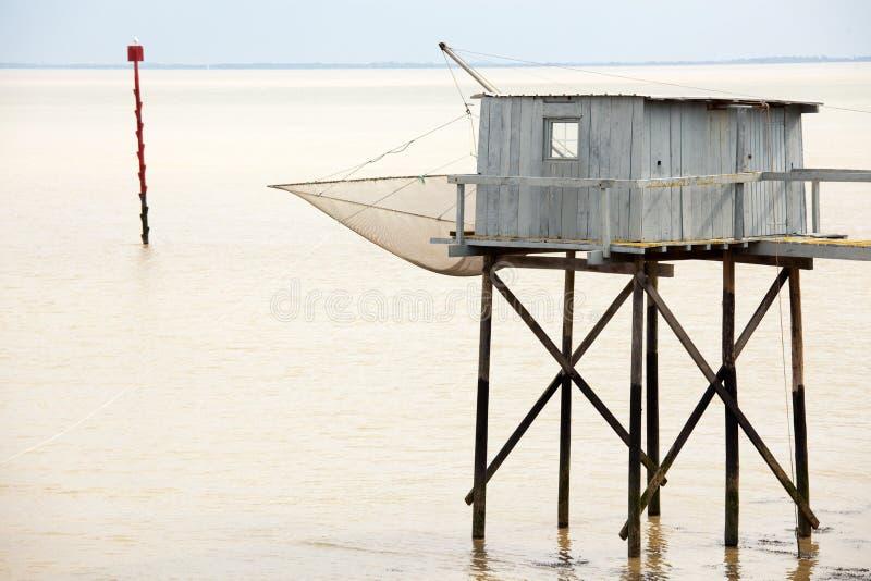 Cabina del Fisher su acqua immagini stock