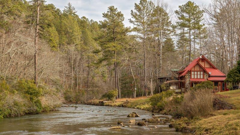 Cabina por The Creek imagen de archivo libre de regalías