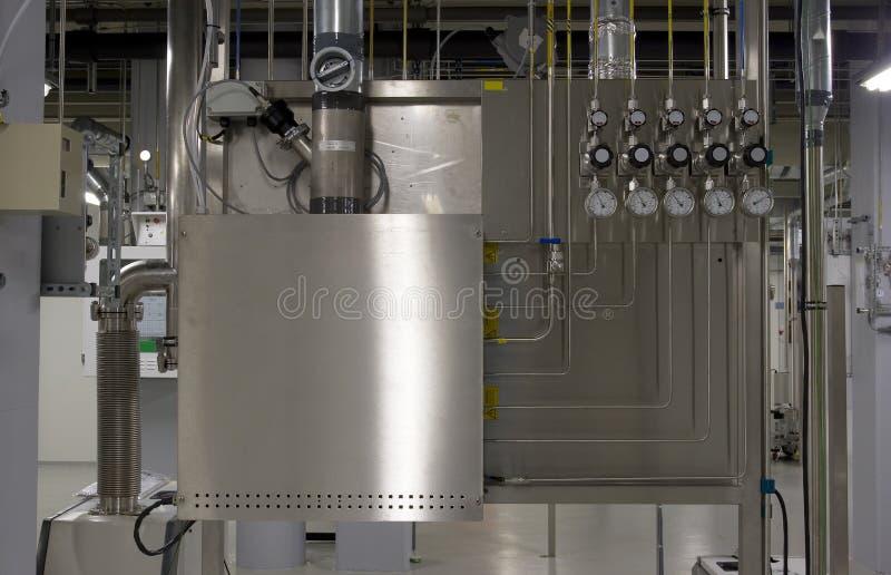 Cabina y múltiple del gas imagenes de archivo