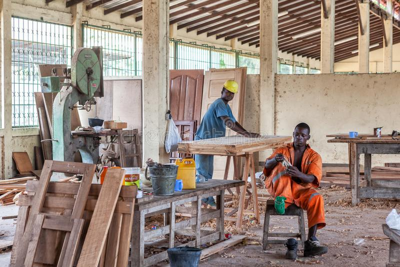 CABINDA/ANGOLA - 08JUN2010 - carpentry factory with African operators royalty free stock photos