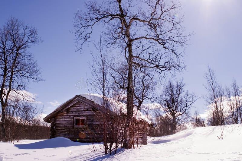 Cabine do inverno imagem de stock