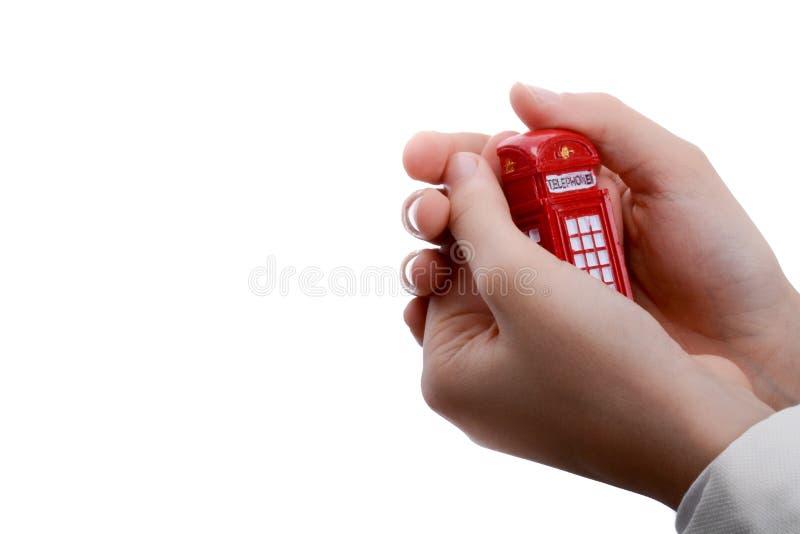 Cabine téléphonique disponible image stock