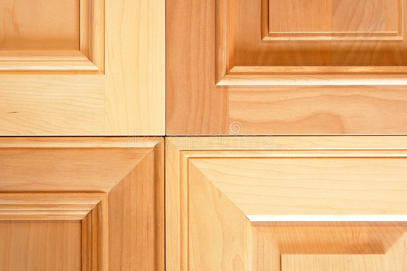 Cabinet Doors. Samples of four different styles of kitchen cabinet doors. Two maple door profiles and two cherry
