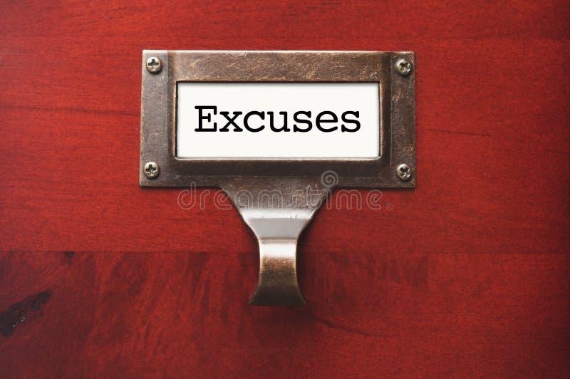 Cabinet en bois brillant avec le label de dossier d'excuses photo stock