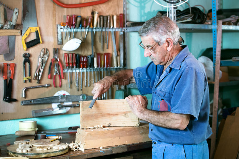 Cabinetmaker filing in the bench in garage at home stock images