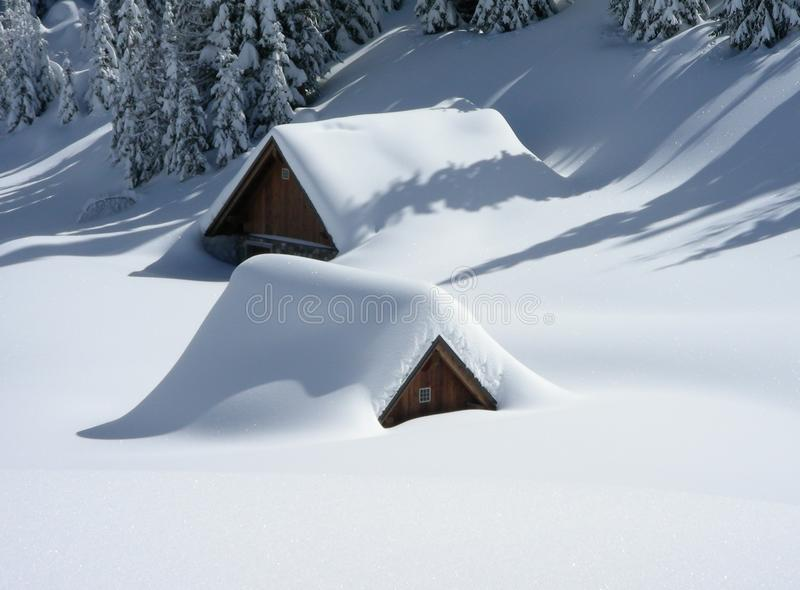 Cabins covered in snow royalty free stock photography